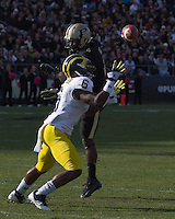 Michigan defensive back Raymon Taylor intercepts a pass intended for Purdue wide receiver OJ Ross and scores on a 63-yard interception return for a touchdown. . The Michigan Wolverines defeated the Purdue Boilermakers 44-13 on October 6, 2012 at Ross-Ade Stadium in West Lafayette, Indiana.