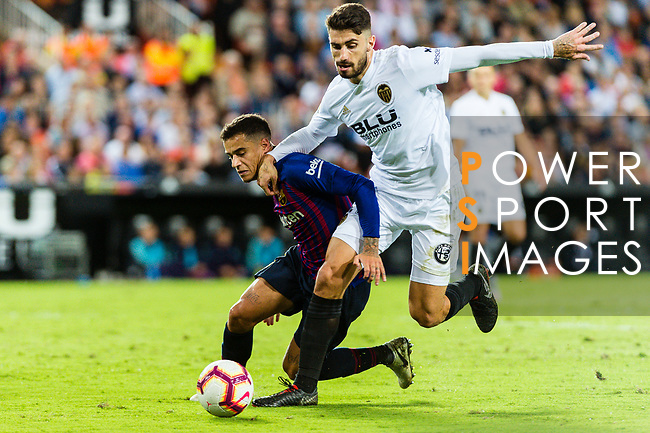 Philippe Coutinho of FC Barcelona (L) battles for the ball with Cristiano Piccini of Valencia CF (R) during their La Liga 2018-19 match between Valencia CF and FC Barcelona at Estadio de Mestalla on October 07 2018 in Valencia, Spain. Photo by Maria Jose Segovia Carmona / Power Sport Images