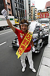 July 6, 2010 - Tokyo, Japan -  Candidate for the upcoming upper house election Hidemitsu Sano and his election campaign motorcycle are pictured in Tokyo on July 6, 2010. Founder of the The Shinto Honshitsu (Essential Party) in 2009, Sano is a one-man band self-styled political party who has a passion for tuned cars and motorcycles, which are a feature of his political campaigning.