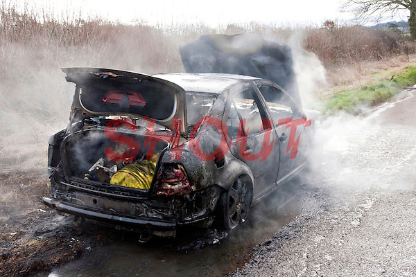 Remains of an abandoned car smouldering following a severe fire..©shoutpictures.com..john@shoutpictures.com