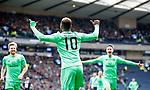 Moussa Dembele celebrates after scoring Celtic's third goal