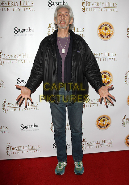 LARRY HANKIN .10th Annual International Beverly Hills Film Festival - Opening Night held At The Clarity Theatre,  Beverly Hills, California, USA, .14th April 2010..full length Black jacket jeans trainers purple t-shirt hands gesture .CAP/ADM/KB.©Kevan Brooks/AdMedia/Capital Pictures.