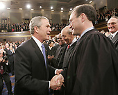 United States President George W. Bush greets newly appointed Associate Justice of the Supreme Court Samuel A. Alito, Jr., right, as he makes his way into the House Chamber to deliver his annual State of the Union speech before a joint session of Congress, at the U.S. Capitol in Washington, Tuesday, January 31, 2006.                     Credit: Pablo Martinez Monsivais / Pool via CNP