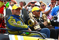 Jun. 2, 2013; Englishtown, NJ, USA: NHRA funny car driver Matt Hagan (left) and top fuel driver Shawn Langdon celebrate after winning the Summer Nationals at Raceway Park. Mandatory Credit: Mark J. Rebilas-