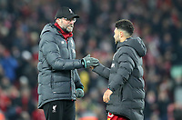 30th November 2019; Anfield, Liverpool, Merseyside, England; English Premier League Football, Liverpool versus Brighton and Hove Albion; Liverpool manager Jurgen Klopp shakes hands with Alex Oxlade-Chamberlain of Liverpool after the final whistle - Strictly Editorial Use Only. No use with unauthorized audio, video, data, fixture lists, club/league logos or 'live' services. Online in-match use limited to 120 images, no video emulation. No use in betting, games or single club/league/player publications