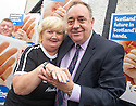 First Minister Alex Salmond on the campaign trail in Ellon has a look at Jacquie Lafferty, 63, Saltire painted fingernails.