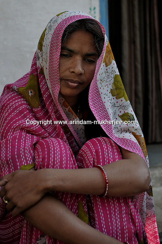 Yasodha stays at Seeshvi village near Udaipur. She is attached to Sadhna for a long time. Her husband was an alchoholic for which he lost is job. Yosdha used to run her family. Four months ago her husband committed sucide. She is now concerned about her two boys who still goes to school. Sadhna is her only earning support now. Udaipur, Rajasthan, India. 25.1. 2011. Arindam Mukherjee.