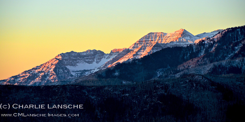 The first rays of light cast a warming light on the majestic monolith of Mount Timpanogos. Wasatch Mountains, Utah. November 2011.