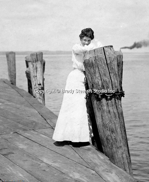 Lakewood NY: Young woman waiting for the City of Cleveland Ferry on the Kent House Pier - 1901. Photographs taken during a church field trip to Chautauqua Institution in New York (Lake Chautauqua). The Stewart family and friends visited Chautauqua during 1901 to hear Stewart relative, Dr. S.H. Clark  speak at the institute. Alice Brady Stewart chaperoned and Brady Stewart came along to photograph the trip.  The Gallery provides a glimpse of how the privileged and church faithful spent summers at Lake Chautauqua at the turn of the century.