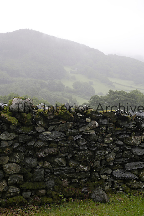 View over a a granite wall to the Welsh mountains beyond