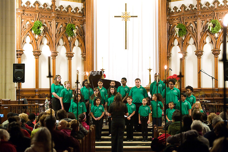 WATERBURY,  CT-122114JS01- Members of the Waterbury Youth Chorus, sing during the 12th annual &quot;A Cool Yule&quot; jazz concert Sunday at St. John's Church in Waterbury. Patrons were asked to bring non-perishable food times to support the Greater Waterbury Interfaith Ministries. <br />  Jim Shannon Republican-American