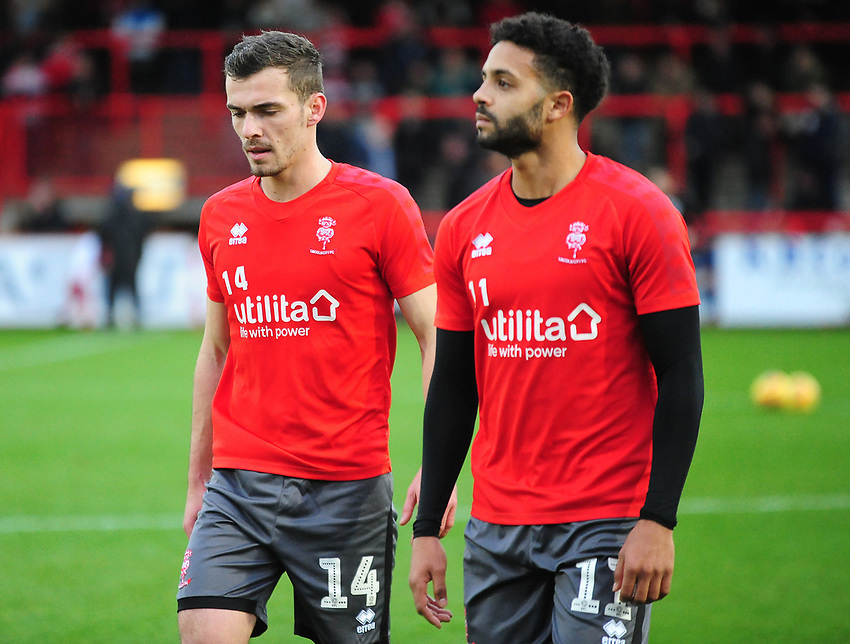 Lincoln City's Harry Toffolo and Bruno Andrade during the pre-match warm-up<br /> <br /> Photographer Andrew Vaughan/CameraSport<br /> <br /> The EFL Sky Bet League Two - Stevenage v Lincoln City - Saturday 8th December 2018 - The Lamex Stadium - Stevenage<br /> <br /> World Copyright © 2018 CameraSport. All rights reserved. 43 Linden Ave. Countesthorpe. Leicester. England. LE8 5PG - Tel: +44 (0) 116 277 4147 - admin@camerasport.com - www.camerasport.com