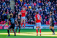 Barnsley's midfielder Joe Williams (4) heads the ball inside during the Sky Bet Championship match between Barnsley and Leeds United at Oakwell, Barnsley, England on 25 November 2017. Photo by Stephen Buckley / PRiME Media Images.