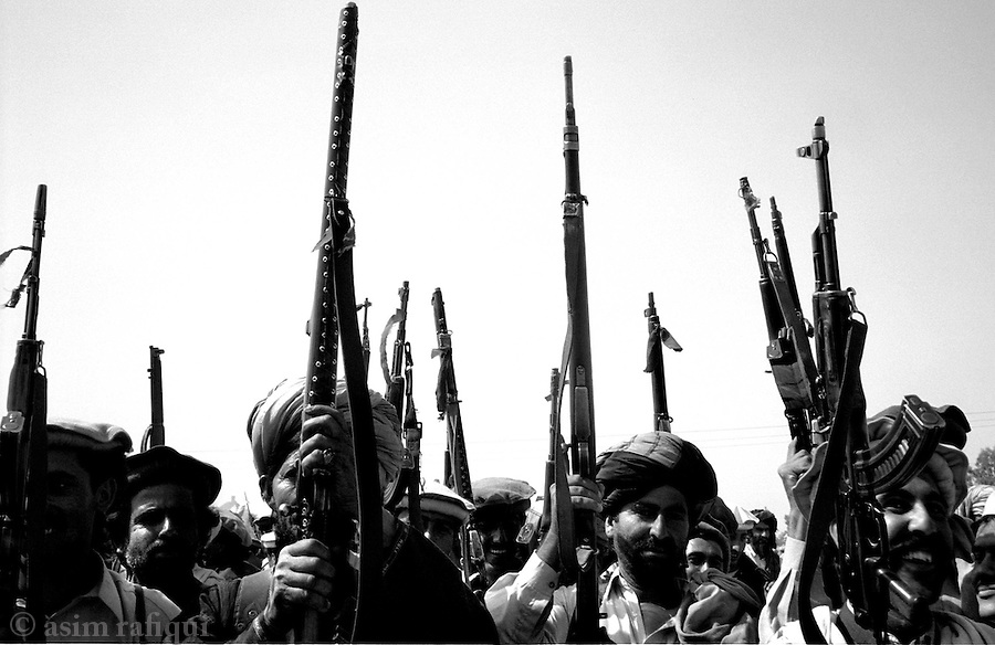 wana, waziristan, april 2004: members of the ahmedzai lashkar, responsible for tracking suspected al qaeda fighters hiding out in the waziristan hills, prepares to begin their search.  men from all the ahmedzai tribes had gathered to form a lashkar over 2000 men strong.<br />