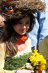 Easter Parade in New York City. A girl wearing a bird nest on her head on Fifth Avenue in New York City during the Easter Day Parade.