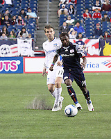 New England Revolution forward Sainey Nyassi (14) and San Jose Earthquakes midfielder Bobby Convey (11) chase down the ball.  The New England Revolution and San Jose Earthquakes play to a scoreless draw at Gillette Stadium on May 15, 2010