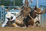 Luke Butterfield from Ponoka, Alberta Canada struggles to get free after his saddle bronc horse fell down during the Reno Rodeo on Monday, June 25, 2013 in Reno, Nevada.<br />