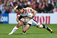 Kenki Fukuoka of Japan is tackled to ground by Richie Gray of Scotland. Rugby World Cup Pool B match between Scotland and Japan on September 23, 2015 at Kingsholm Stadium in Gloucester, England. Photo by: Patrick Khachfe / Stewart Communications