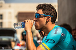 Omar Fraile Matarranz (ESP) Astana Pro Team hydrates at sign on before the start of Stage 2 of the 2018 Tour of Oman running 167.5km from Sultan Qaboos University to Al Bustan. 14th February 2018.<br /> Picture: ASO/Muscat Municipality/Kare Dehlie Thorstad | Cyclefile<br /> <br /> <br /> All photos usage must carry mandatory copyright credit (&copy; Cyclefile | ASO/Muscat Municipality/Kare Dehlie Thorstad)