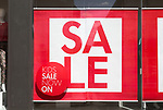 Close up M & Co store sale posters in shop window, Woodbridge, Suffolk, England, UK Kids Sale now on