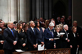 From left, President Donald Trump, first lady Melania Trump, former President Barack Obama, former first lady Michelle Obama, former President Bill Clinton, former Secretary of State Hillary Clinton, and former President Jimmy Carter and former first lady Rosalynn Carter participate in a State Funeral at the National Cathedral for former President George H.W. Bush, Wednesday, Dec. 5, 2018, in Washington.<br /> Credit: Alex Brandon / Pool via CNP