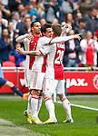 Nederland, Amsterdam, 30 maart 2014<br /> Eredivisie<br /> Seizoen 2013-2014<br /> Ajax-FC Twente<br /> Bojan Krkic (m.) van Ajax juicht nadat hij de 3-0 heeft gescoord. V.l.n.r.: Ricardo van Rhijn, Bojan Krkic en Lasse Schone van Ajax.