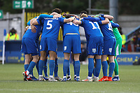 Wimbledon team huddle during AFC Wimbledon vs Burton Albion, Sky Bet EFL League 1 Football at the Cherry Red Records Stadium on 9th February 2019