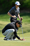 Lafayette HS golfer Max Kreikemeier positions his ball to putt. In background is Francis Howell HS golfer Cole Prager. The District 3 Boys Golf Championships were held at The Quarry at Crystal Springs Golf Course on Monday April 30, 2018. Tim Vizer | Special to STLhighschoolsports.com
