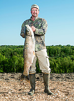 Winner of the 2014 Bass Pro U.S. Open Bowfishing Championship, Greg Campbell (cq), after his weigh in, Sunday, May 4, 2014. They caught 354.4 pounds of carp during the competition.<br /> <br /> Photo by Matt Nager