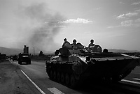 Sveneti, near Gori, Georgia, August 13, 2008.A Russian military column of about 80 vehicles calmly drives out of Gori towards Tbilissi on the main highway in obvious contradiction with the cease-fire afreed less than 24 hours before.