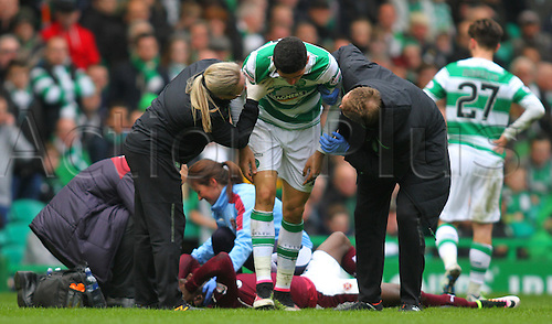 02.04.2016. Celtic Park, Glasgow, Scotland. Scottish Football Premiership Celtic versus Hearts. Tom Rogic is helped to his feet by the coaching staff after his head knock