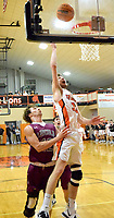 Westside Eagle Observer/MIKE ECKELS<br /> <br /> Brayden Trembly (33) goes high to get a jumper into the basket during the Gravette-Lincoln boys basketball game in Gravette Dec. 3.
