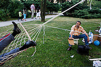 ISTANBUL - MAY 27, 2007:   Two men enjoy a Turkish afternoon by relaxing in a park in Istanbul, Turkey. Photo by Landon Nordeman.