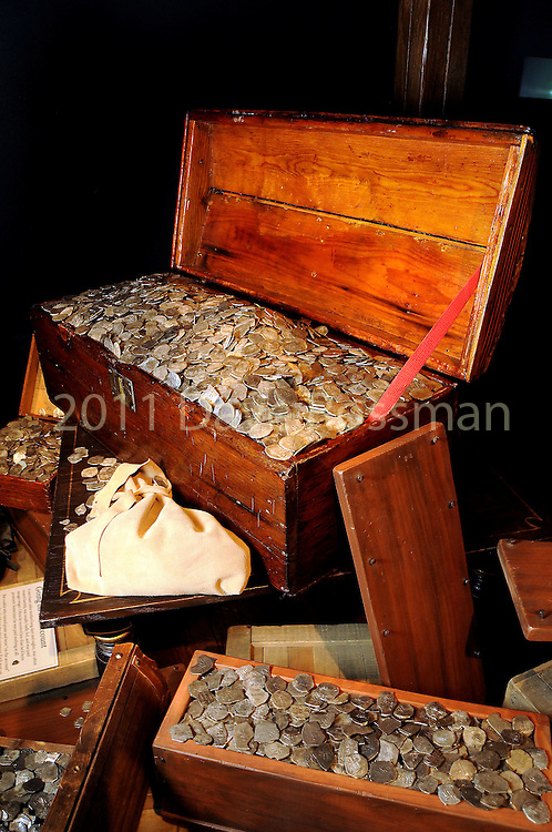A treasure chest full of silver coins at a VIP preview of Real Pirates: The Untold Story of the Whydah from Slave Ship to Pirate Ship at the Houston Museum of Natural Science Wednesday Oct. 06, 2010. (Dave Rossman/For the Chronicle)