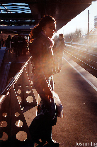 A woman stands on the platform of west Amsterdam's Lelylaan metro station. .Picture taken 2005 by Justin Jin