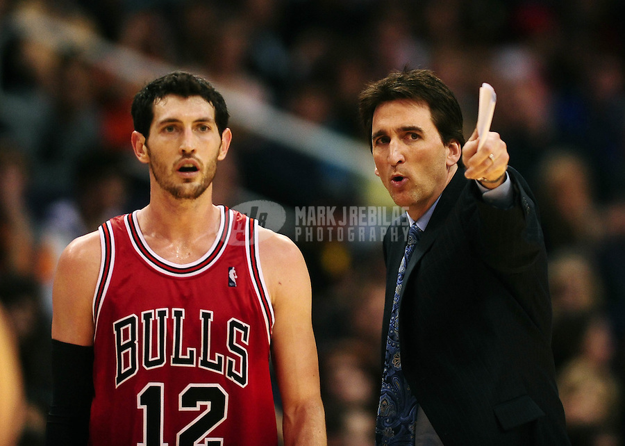 Jan. 22, 2010; Phoenix, AZ, USA; Chicago Bulls guard (12) Kirk Hinrich with head coach Vinny Del Negro against the Phoenix Suns at the US Airways Center. Chicago defeated Phoenix 115-104. Mandatory Credit: Mark J. Rebilas-