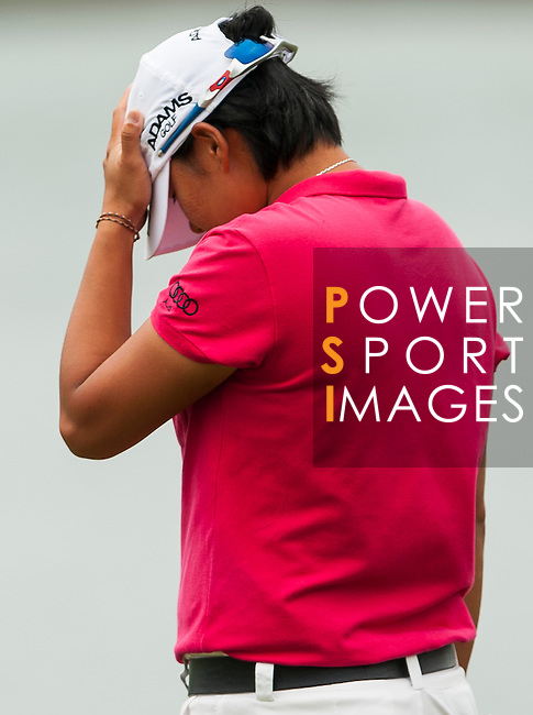 TAOYUAN, TAIWAN - OCTOBER 28:  Yai Tseng of Taiwan reacts after missing a birdie on the 14th hole during the day four of the Sunrise LPGA Taiwan Championship at the Sunrise Golf Course on October 28, 2012 in Taoyuan, Taiwan.  Photo by Victor Fraile / The Power of Sport Images