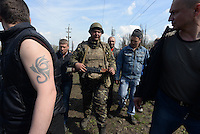 Ukrainian forces are being blocked by local citizens near Kramatorsk city during the anti-terrorist operation. Disarmed soldier