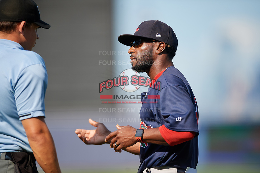 Lowell Spinners manager Corey Wimberly (13) talks with home plate umpire Jordan Sandberg during a game against the Staten Island Yankees on August 22, 2018 at Richmond County Bank Ballpark in Staten Island, New York.  Staten Island defeated Lowell 10-4.  (Mike Janes/Four Seam Images)