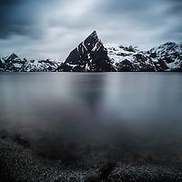 Dark skies over Olstind mountain peak, near Hamnoy, Lofoten Islands, Norway