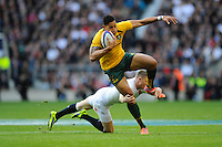 Israel Folau of Australia escapes the tackle of Chris Ashton of England during the QBE Autumn International match for the Cook Cup between England and Australia at Twickenham on Saturday 2nd November 2013 (Photo by Rob Munro)