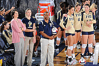 17 November 2011:  FIU Head Coach Danijela Tomic (far left), with Assistant Coaches Ines Medved and Trevor Theroulde watch as Denver's team warms up prior to the match (also pictured, Andrea Lakovic (1), Jessica Egan (6) and Sabrina Gonzalez (12)).  The FIU Golden Panthers defeated the Denver University Pioneers, 3-1 (25-21, 23-25, 25-21, 25-18), in the first round of the Sun Belt Conference Tournament at U.S Century Bank Arena in Miami, Florida.