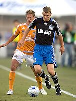 22 May 2008: Ronnie O'Brien of the Earthquakes dribbles the ball away from Stuart Holden of the Dynamo during the first half of the game at Buck Shaw Stadium in San Jose, California.   San Jose Earthquakes and Houston Dynamo are tied 0-0 at halftime.