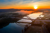 What a spectacular sunrise. It doesn't get much better than this I was thinking as I flew my drone up to the heavens to capture this colorful image of the sunrise rising over the 360 Pennybacker Bridge as steam fog rises off Lake Austin to form clouds above the limestone cliffs lining the lake.