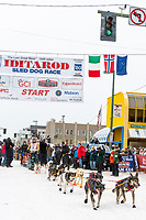 Nils Hahn and team leave the ceremonial start line with an Iditarider and handler at 4th Avenue and D street in downtown Anchorage, Alaska on Saturday March 7th during the 2020 Iditarod race. Photo copyright by Cathy Hart Photography.com