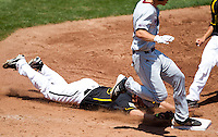 Albert Minnis (33) of the Wichita State Shockers does not tag first base in time before a base runner reaches the base during a game against the Missouri State Bears in the 2012 Missouri Valley Conference Championship Tournament at Hammons Field on May 23, 2012 in Springfield, Missouri. (David Welker/Four Seam Images).