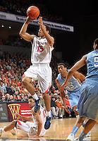 Virginia guard Malcolm Brogdon (15) shoots in front of North Carolina forward James Michael McAdoo (43) during the second half of an NCAA basketball game Monday Jan. 20, 2014 in Charlottesville, VA. Virginia defeated North Carolina 76-61.