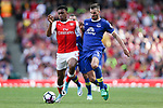 Alex Iwobi of Arsenal and Everton's Morgan Schneiderlin during the English Premier League match at the Emirates Stadium, London. Picture date: May 21st 2017.Pic credit should read: Charlie Forgham-Bailey/Sportimage