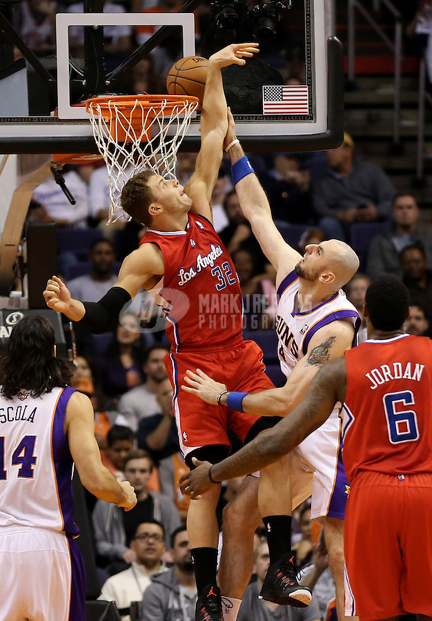 Jan. 24, 2013; Phoenix, AZ, USA: Los Angeles Clippers forward Blake Griffin (32) blocks the shot of Phoenix Suns center Marcin Gortat in the first quarter at the US Airways Center. Mandatory Credit: Mark J. Rebilas-USA TODAY Sports