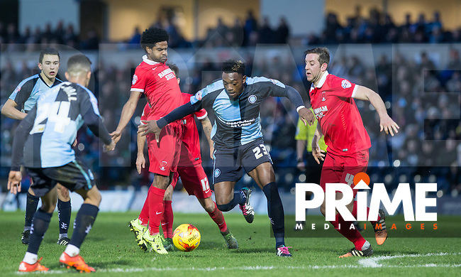Gozie Ugwu of Wycombe Wanderers  battles through Orient players during the Sky Bet League 2 match between Wycombe Wanderers and Leyton Orient at Adams Park, High Wycombe, England on 23 January 2016. Photo by Andy Rowland / PRiME Media Images.